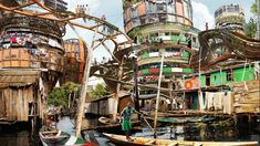 Many of his images feature Lagos Makoko Canal, the infamous floating slum. Population estimates range from 85,000 to 250,000.
