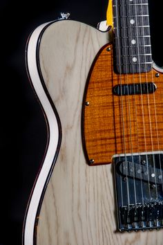 """One of our proprietary finishes! We call it """"Milk White"""". This was done on an Ash wood Telecaster body, included with a burnt orange stained flamed maple pick guard."""