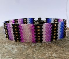 Bracelet in Pinks and Violet Seed Beads by SierraBeader on Etsy, $55.00