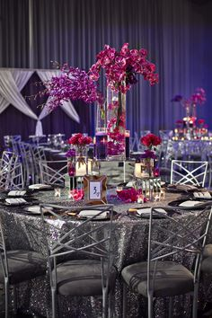 Towering centerpieces purple pink on silver sequin linen tablecloth orchids tall flowers full, Flowers by The Crimson Petal, #thecrimsonpetal, thecrimsonpetal.net