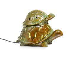 """Turtle Trek ScentGlow Warmer - Baby turtle hitches a ride on Mama for a playful warmer design. Electric warming plate diffuses the fragrance of Scent Plus® Melts or scented oil, sold separately. Baby is lid, remove for stronger fragrance throw. Ceramic with reactive glaze is highlighted by a hidden LED light. Black cord. 5""""h, 7 1/4""""w.   Only $35"""