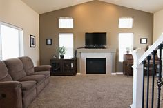 The vaulted ceilings and center fireplace give the living room of 2308 Big Lost a very elegant feel. What do you think? Call Kimber Parker - Team Properties Group for your showing today 307-670-2750