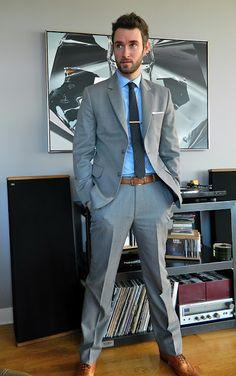 grey suit, brown shoes