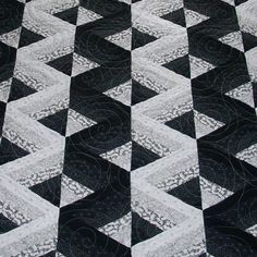 Optical illusion quilt -- would be fun with any two contrasting colors.