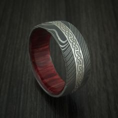 Damascus Steel Celtic Ring With Platinum Inlay And Wood Sleeve Custom Made Band Celtic Knot Ring, Celtic Wedding Rings, Custom Wedding Rings, Celtic Rings, Wedding Bands, Damascus Ring, Damascus Steel, Celtic Knot Designs, Iron Ring