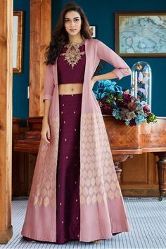 Designer dresses indian - Cast a spell as you wear this flattering magenta designer lehenga choli set featuring zari worked motifs enriching the lehenga while choli stands out in zari & gota embroidery at the neckline in a stu Designer Party Wear Dresses, Kurti Designs Party Wear, Indian Designer Outfits, Lehenga Anarkali, Lehnga Dress, Jacket Lehenga, Pink Lehenga, Lehenga With Long Choli, Shaadi Lehenga