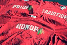 """You all seemed to like the red Pride t-shirt so much, we decided to give some away! And heck, we even had the team sign 'em. Three lucky repinners will snag these """"signature"""" tees before our home opener on Jan. 22. Good luck!"""