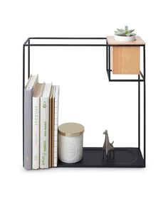 Umbra Cubist Wall DisplayCubist is the creative combination of storage and display that is designed to be functional while at the same time adding a modern decorative touch to any room in your home or office. Made of a square rod frame with an integrated shelf, Cubist is ideal for storing and displaying a variety of items including books, magazines, figurines, mementos, and more. To further enhance Cubist's functionality and visual appeal, there is a built-in natural Beech wood container…