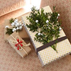 Garnish Gifts with Pretty Greenery and Miniature Ornaments--this would nice to do to empty boxes to use as decor (let's be honest, most ppl would look at you pretty funny if you put a branch on the front of their present).
