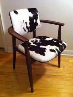 Retro-Wow! Chair - Vintage Scandinavian style chair covered in real cow hide and black decorative nails From Motique Decor