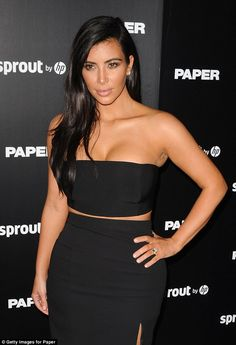 Natural beauty: She wore her dark hair loose and over one shoulder, and opted for a smokey eye and nude lips