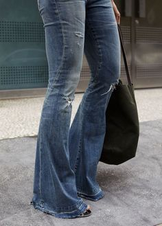 Blogger Michelle Madsen of Michelle Take Aim wearing a pair of Citizens of Humanity Charlie Super Flare jeans in Blue Grass.