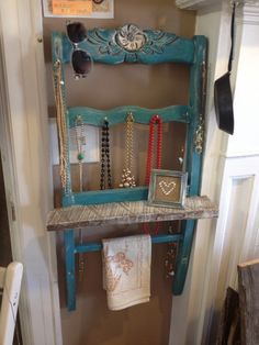 Jewelry organizer made from an old chair. Used a piece of whitewashed barnwood for the small shelf.