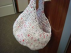 Crochet using plarn (plastic bag yarn)! This is awesome! I am so doing this once I can get past the basic rectangle.