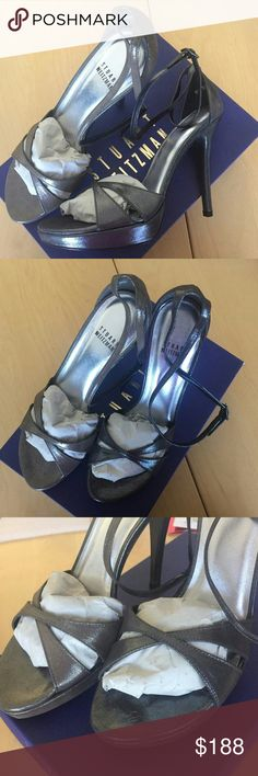 "STUART WEITZMAN EXCITING SANDALS STUART WEITZMAN GLOSPRAY SILVER HIGH HEEL DRESS SANDALS     SIZE 8.5 M    BRAND NEW.  Sticker residue on one heel. Shelf wear to box.    Nero Pindot - this is a dark sparkley graphite color.    5"" Heel.    Straps wrap around and then fasten around the ankle. Stuart Weitzman Shoes Heels"