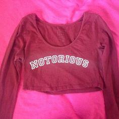 """Notorious Crop Top Burgundy long sleeve crop top with """"Notorious"""" in white Tops Crop Tops"""