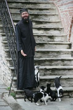 Orthodox monk with cats.