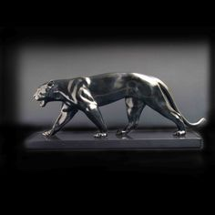 Baghera, Art Deco Panther in black patinated cast metal — sculptor: Max le Verrier