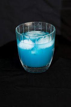Into The Blue     (1 shot light rum  1/2 shot of Blue Curaçao  1 1/2 shots of grapefruit juice  club soda)