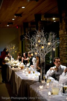 centerpiece idea...I'm liking this whole - branches with dangling candles and gems - thing...