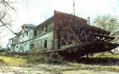 the stories this big old paddleboat could tell. Abandoned but an odd beauty.