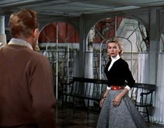 "Here Vera Ellen (as ""Judy"" in White Christmas) wears a fabulous circle skirt, detailed belt, and fitted black sweater.  So pretty!"