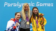 Silver medallist Heather Frederiksen of Great Britain, gold medallist Jessica Long of the United States and bronze medallist Maddison Elliott of Australia pose on the podium during the medal ceremony for the Women's 400m Freestyle - S8 Final on Day 2