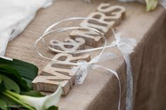 Silver wedding bands with white lace ribbon.
