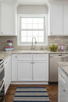 Unique Backsplash with White Cabinets and Grey Countertop