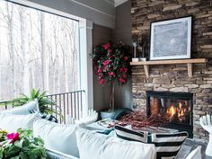 With a charming fireplace and enough space for a dining and lounging area, the screened porch off the living room is a stylish spot to entertain outdoors.