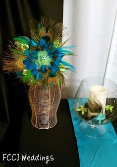 pecok center peaces | Peacock inspired wedding centerpieces | Wedding Ideas