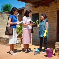 Two of Jehovah's Witnesses preach to a woman in Paraguay