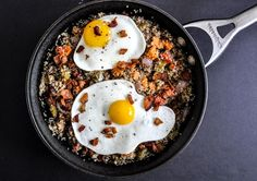 quinoa breakfast skillet with sweet potato, veggies, bacon and fried eggs  {How Sweet Eats}