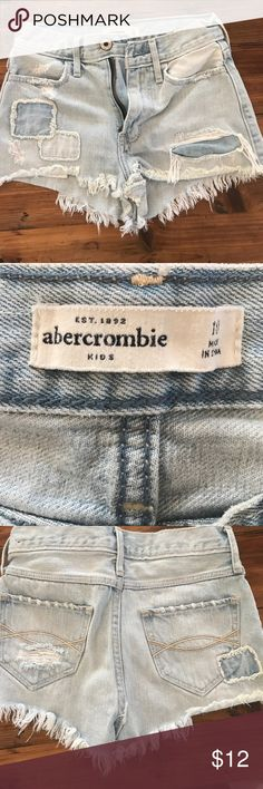 Abercrombie Kids Fringed Denim Cut-off shorts Abercrombie Kids stylish light-blue Denim shorts with fringe. It runs small and does not have any interior stretch adjustment capability. Abercrombie runs small. A size ten fits a 7-8 year old. Worn twice. Abercombie Kids Bottoms Shorts