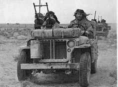 SAS jeep (with single Vickers K at rear, vehicle at rear armed with .30' cal and twin Vickers K at rear):