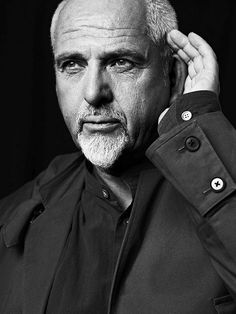 Peter Gabriel holding the 'Hear the World' pose to help raise awareness about hearing loss (photography by Bryan Adams)