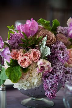 Spring centerpiece with Tulips, Roses, Lilac, and Hydrangea