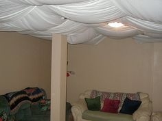 DIY Unfinished Basement With Temporary Fabric Ceiling Cover