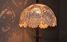 Doily Lampshade Tutorial I guess, if you want shadow pictures on the wall, this is a good a place to start as any. if you want a bat signal, make sure the top part is either cut to a bat signal sign, ir completely darkened