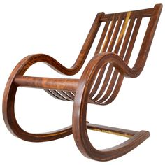Walnut Rocking Chair | From a unique collection of antique and modern rocking chairs at https://www.1stdibs.com/furniture/seating/rocking-chairs/