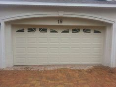 Amarr Stratford series short panel garage door with sunray inserts installed in Jacksonville Garage Door Panels, Garage Door Installation, America, Outdoor Decor, Home Decor, Decoration Home, Room Decor, Home Interior Design, Usa
