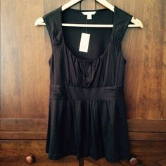 """Banana Republic dark brown babydoll top Banana Republic dark brown babydoll  top Silky 100% rayon.  Flowy fit from pleated bust Slightly ruched band under bust 14-1/2"""" pit to pit 25"""" back of neck to bottom Banana Republic Tops"""