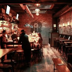 Hidden behind a coffee bar in NYC's Alphabet City is The Roost, an inviting bar fitted out in reclaimed wood and exposed brick