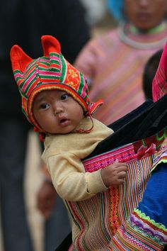 A young Flower Hmong child dressed up for the Saturday market in Can Cau. VIETNAM