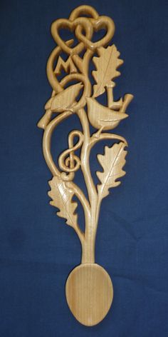Love birds and oak leaves love spoon.