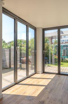 Contemporary floor to ceiling corner doors to rear extension | corner post…
