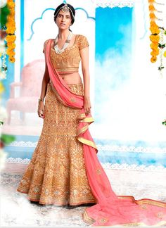Online shopping for latest collection of designer lehenga choli. Shop this silk embroidered and patch border work a line lehenga choli for bridal and wedding.
