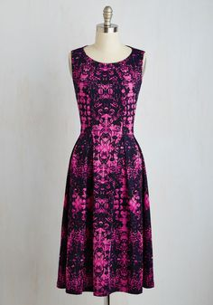 Liven Up the Night Dress in Magenta Blooms. Every entrance you make is bold and beautiful when you wear this patterned midi dress! #pink #modcloth