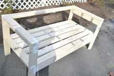 The easiest 2x4 bench plans ever! Based on an Ana White plan, this outdoor sofa can easily be made into a sectional with a little extra work.