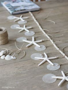 - Shell Crafts - Sea Chimes How to make Sea Chimes or a starfish and capiz shell garland. Seashell Art, Seashell Crafts, Beach Crafts, Diy And Crafts, Arts And Crafts, Seashell Garland, Seashell Wind Chimes, Starfish Wreath, Summer Crafts